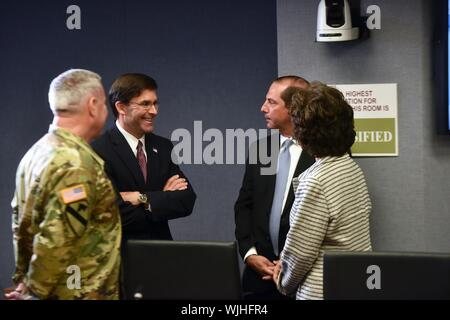 Secretary of Defense Mark Esper, second from left, talks with Secretary of Health and Human Services Alex Azar, third from left, Secretary of Transportation Elaine Chao, right, and Army Maj. Gen. Richard Kaiser, commander, Army Corps of Engineers, before a Hurricane Dorian briefing led by President Donald Trump at the Federal Emergency Management Agency, Washington, D.C, September, 2019. Sept. 1, 2019. (U.S. Army National Guard photo by Sgt. 1st Class Jim Greenhill) Image courtesy Sgt. 1st Class Jim Greenhill/National Guard Bureau. () - Stock Photo