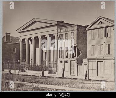 Hibernian Hall, Charleston, S.C Abstract: Photograph shows shell damaged buildings on Meeting Street with Hibernian Hall on the left. - Stock Photo