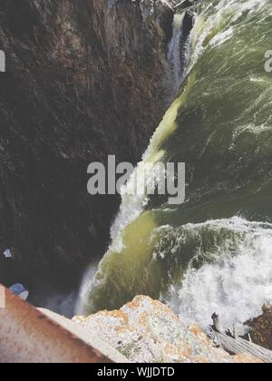 Scenic View Of Waterfall Against Sky - Stock Photo