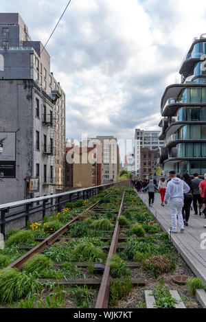New York City, Usa - April 21, 2019: The High Line, the free entry urban public park on an historic rail line, New York City, Manhattan. People are en - Stock Photo
