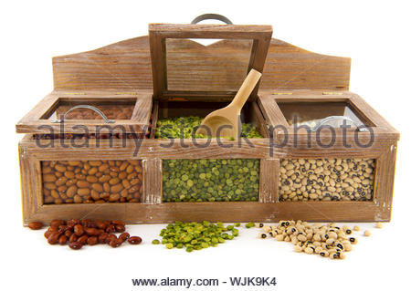 Various dried legumes in wooden shop shelfs - Stock Photo