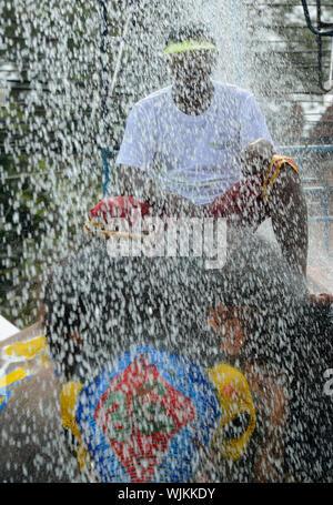 Man Sitting On Elephant In Parade During Rainy Season - Stock Photo