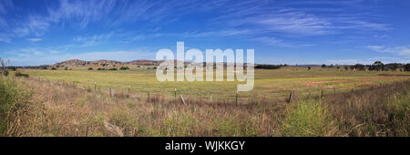 The road is in a rural location, Australia - Stock Photo