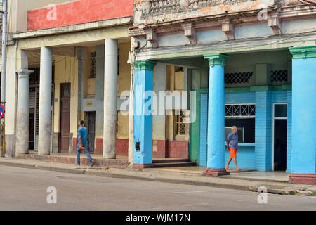 Street photography in central Havana- Colonial architecture with pedestrians and vehicles, La Habana (Havana), Habana, Cuba