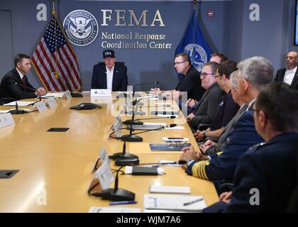 President Donald J. Trump, joined by Acting Secretary of the Department of Homeland Security Kevin McAleenan and Acting FEMA Administrator Pete Gaynor, attends a briefing Sunday, Sept. 1, 2019, on the current directional forecast of Hurricane Dorian at the Federal Emergency Management Agency (FEMA) headquarters in Washington, D.C, September, 2019. (Official White House Photo by Tara A. Molle) Image courtesy Sharon Pieczenik/Federal Emergency Management Agency. () - Stock Photo