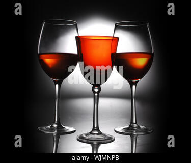 Close-up Of Red Wine In Glasses Against Black Background - Stock Photo