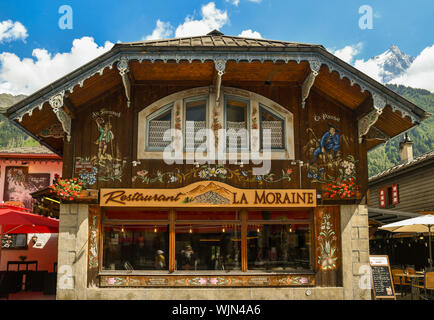 Exterior of a bar restaurant in the centre of Chamonix-Mont-Blanc in typical Savoyard architectural style in a sunny summer day, Haute Savoie, France