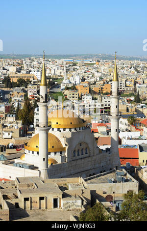 A view of Madaba and the King Hussain Mosque. - Stock Photo