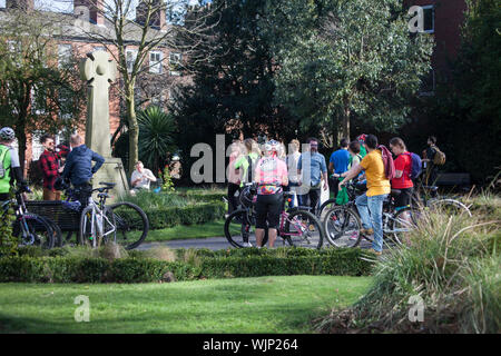 Group of cyclists in a park - Stock Photo