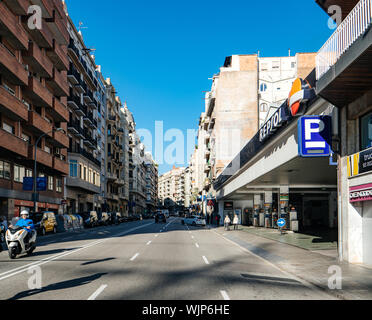 Barcelona, Spain - Nov 13, 2017: Wide Barcelona avenue with Repsol gas station near the apartment buildings and Parking sign - Stock Photo