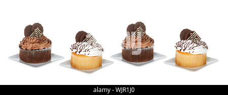 Chocolate and vanilla giant cupcakes on square plates isolated on white. Social media banner format - Stock Photo