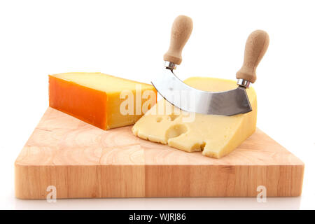 Two blocks of fresh cheese on wooden timber - Stock Photo