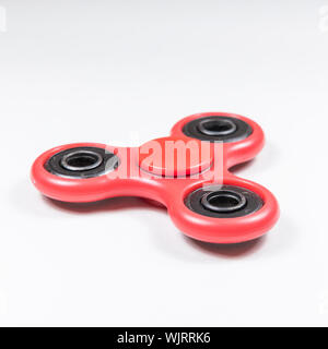High Angle View Of Fidget Spinner Over White Background - Stock Photo