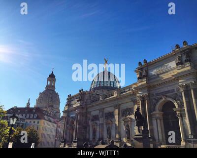 Low Angle View Of Dresden Frauenkirche Against Blue Sky On Sunny Day - Stock Photo