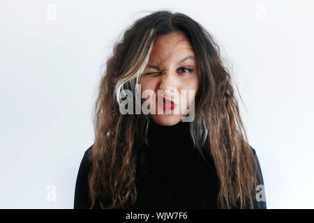 Portrait Of Beautiful Young Woman Against White Background - Stock Photo