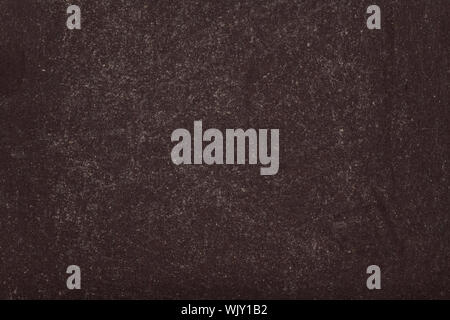 Blank black blackboard with chalk powder traces erased on texture background. - Stock Photo