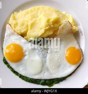 High Angle View Of Fried Eggs With Mashed Potatoes Served In Plate - Stock Photo