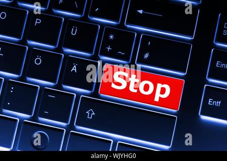 stop key on keyboard in red showing halt concept - Stock Photo