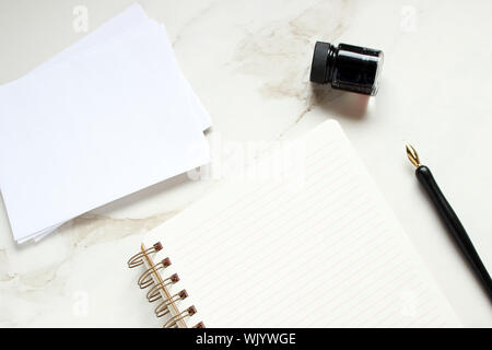 Fountain Pen With Blank Spiral Notebook And Office Supplies On Marble - Stock Photo