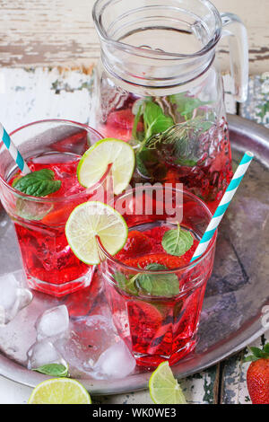 High Angle View Of Cocktail In Glasses And Jar On Wooden Table - Stock Photo
