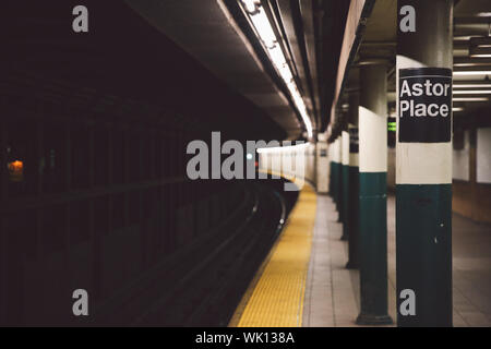 Text On Column At Subway Station - Stock Photo