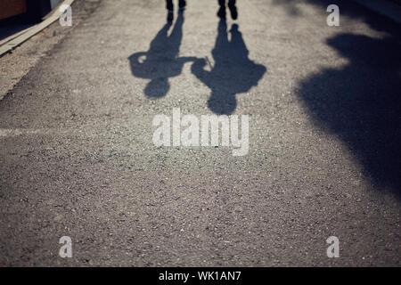 Shadow Of People Walking On Street - Stock Photo