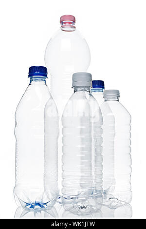 Assorted clear empty plastic recyclable bottles isolated on white - Stock Photo