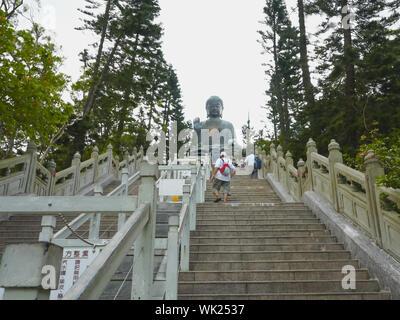 HONG KONG, CHINA- SEPTEMBER, 30, 2017: climbing the steps to tan tian buddha in hong kong - Stock Photo