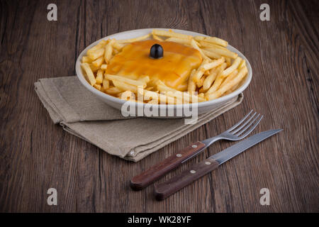 Francesinha on plate, typical food from Porto, Portugal - Stock Photo