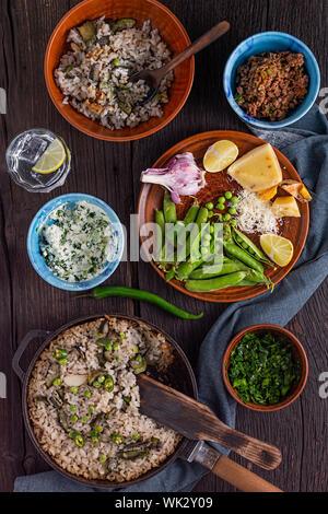 broccoli sauce, lemon, pesto pasta salad, tomato, tomato sauce, sausage, vegetarian, roasted broccoli,  bacon - Stock Photo