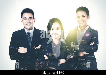 Digital Composite Image Of Illuminated City Against Smiling Business People - Stock Photo