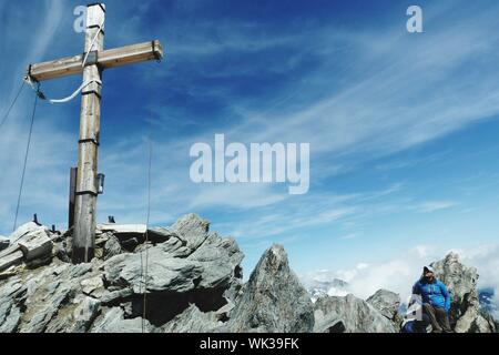 Cross On Rock At Hochfeiler Against Sky - Stock Photo