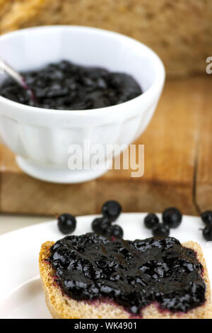 Black Currant Jam On Slice Of Bread - Stock Photo