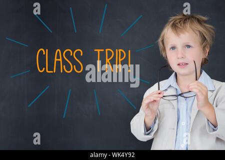 The word class trip! against schoolboy and blackboard - Stock Photo