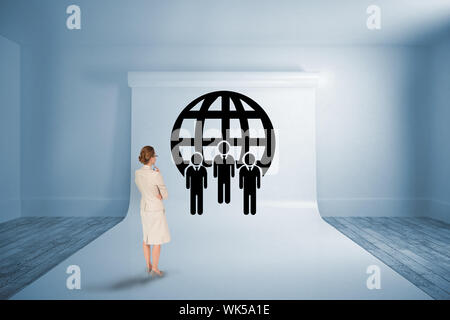 Thinking businesswoman against large white screen showing graphic - Stock Photo
