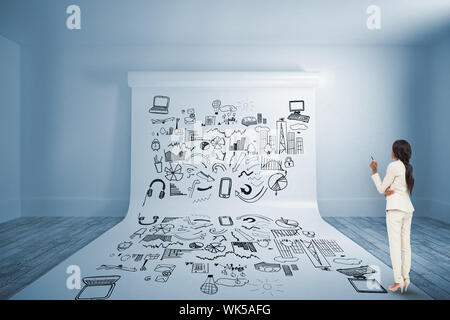 Thinking businesswoman against large white screen showing doodle - Stock Photo