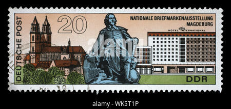 Stamp issued in Germany - Democratic Republic (DDR) shows Magdeburg: Cathedral, monument, hotel, National Stamp Exhibition, circa 1969 - Stock Photo