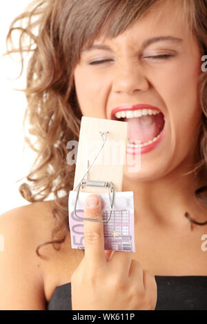 Screaming woman after geting traped by mouse trap with 500 euro
