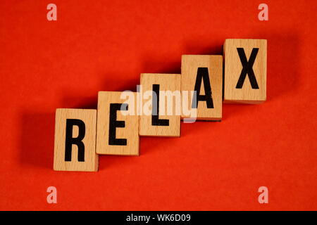 Relax - yoga Word Written In Wooden Cube. cube with letters. dice with text. relaxation concept for spa or health. Yoga, meditation, calm, relax, - Stock Photo