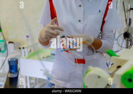 Midsection Of Doctor Holding Syringe In Hospital - Stock Photo