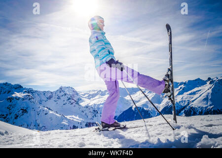 Woman Skiing On Snowy Field During Sunny Day - Stock Photo