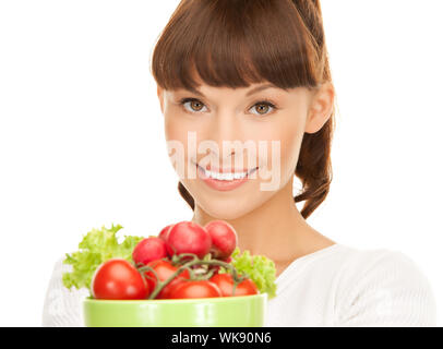 woman in the kitchen with tomatoes - Stock Photo