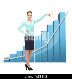 businesswoman pointing at big 3d chart - Stock Photo