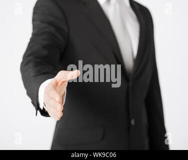 businessman with open hand - Stock Photo