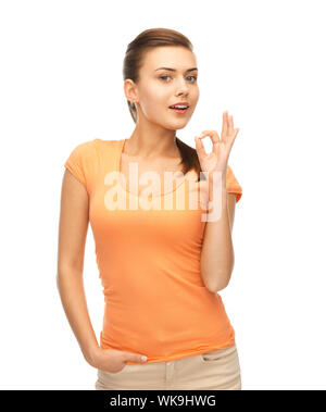 woman in blank color t-shirt showing ok gesture - Stock Photo