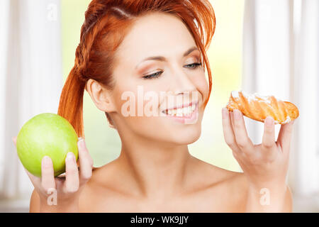 pretty woman with apple and cake - Stock Photo