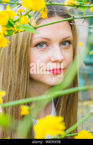 Close-up Portrait Of Young Woman Seen Through Plants - Stock Photo