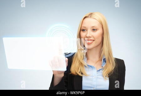 businesswoman touching virtual screen - Stock Photo