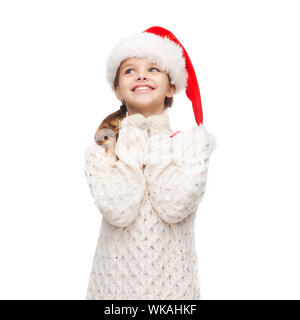 dreaming girl in santa helper hat - Stock Photo