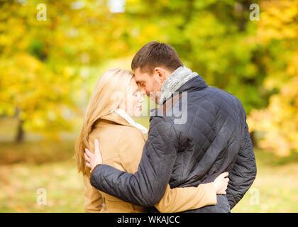 romantic couple kissing in the autumn park - Stock Photo